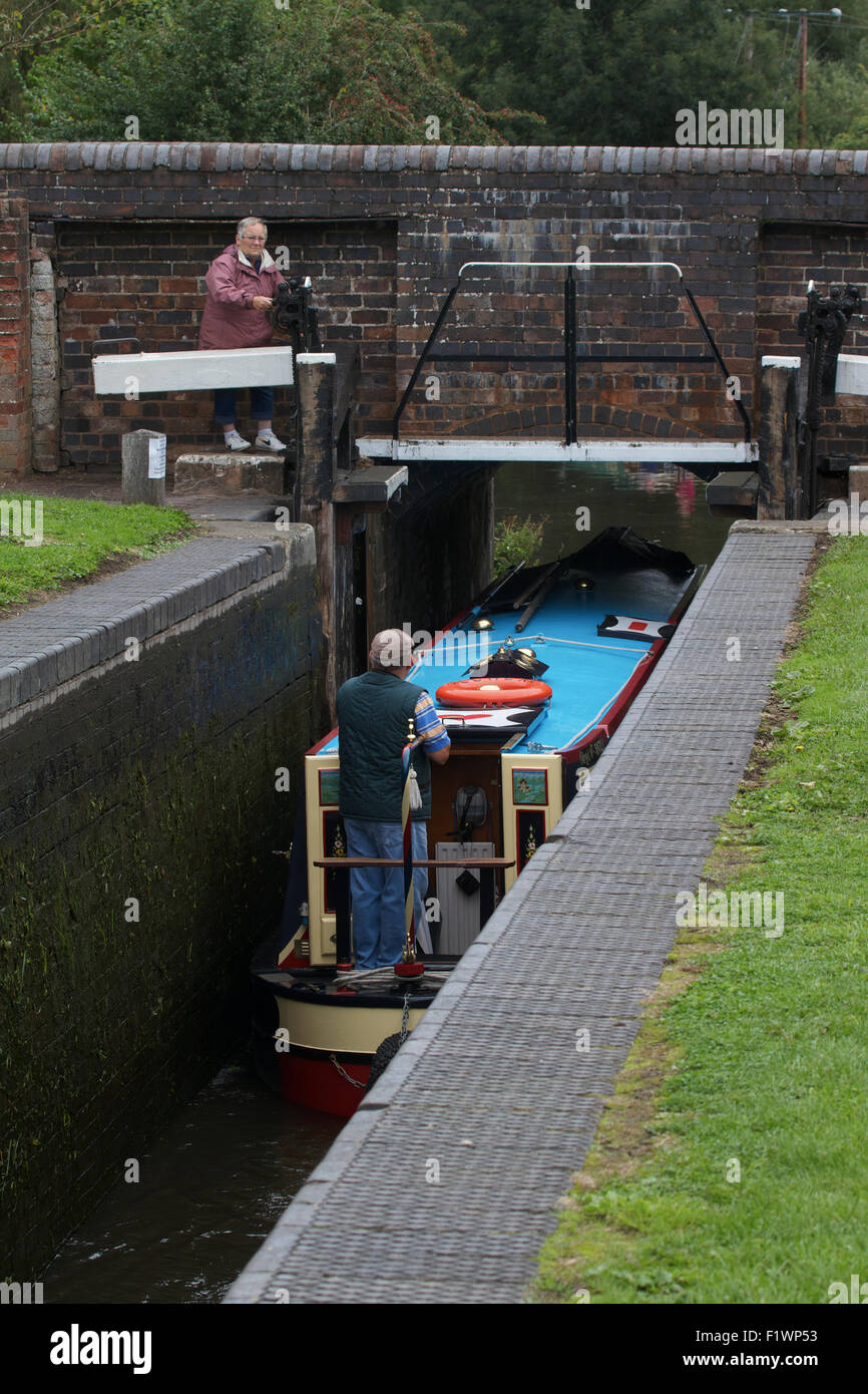Narrow Boat going through lock on the Staffordshire and Worcestershire Canal. UK - Stock Image