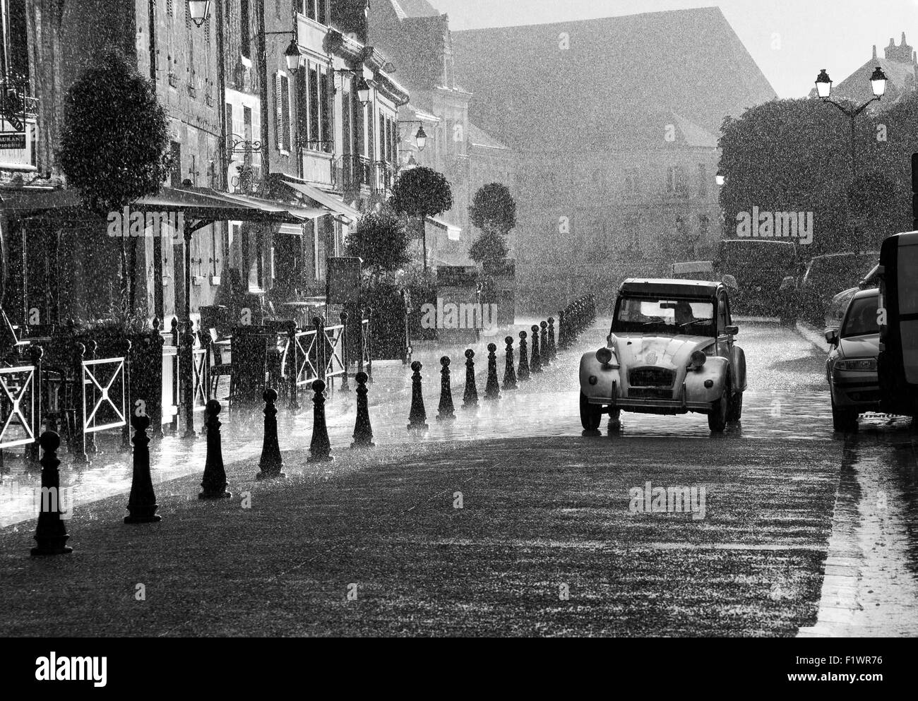 french street scene classic citroen 2cv car driving along a street in stock photo 87233530 alamy. Black Bedroom Furniture Sets. Home Design Ideas