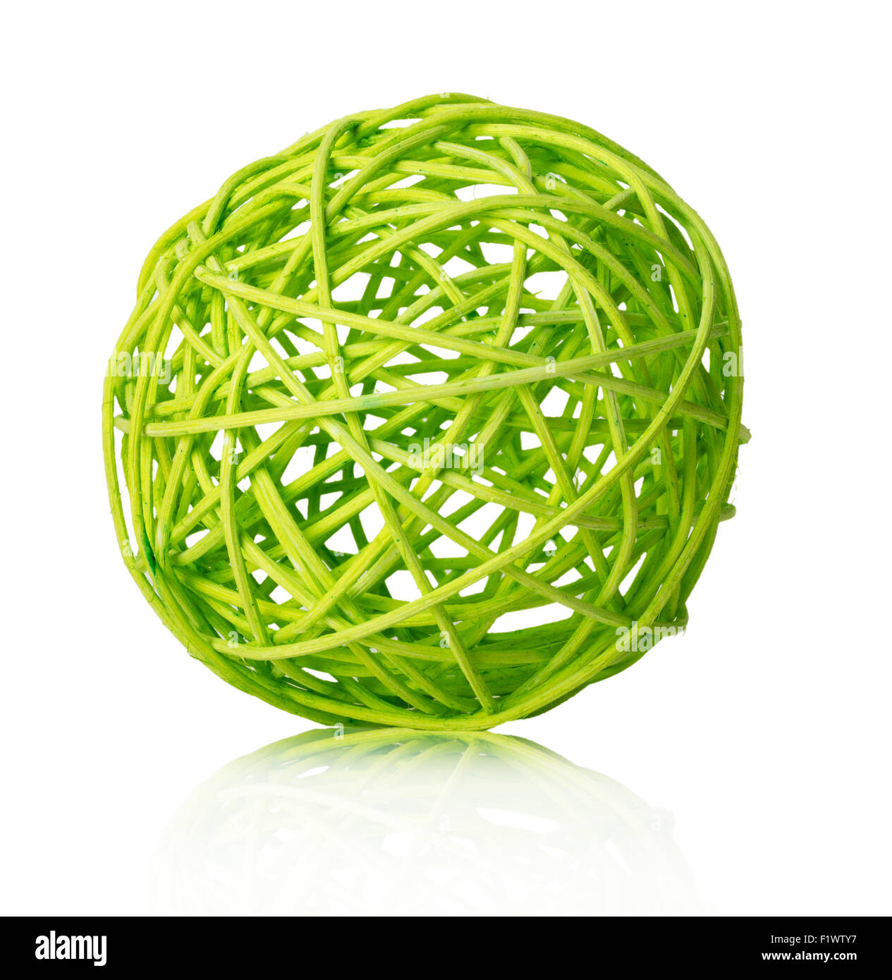 wooden light green white background wool isolated ball roll string cotton yarn golden material clothing on the white - Stock Image