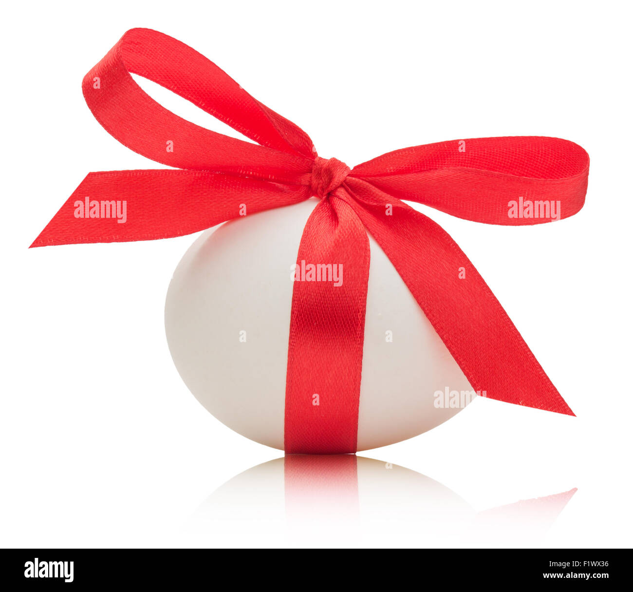 Easter egg with festive red bow isolated on white background. - Stock Image