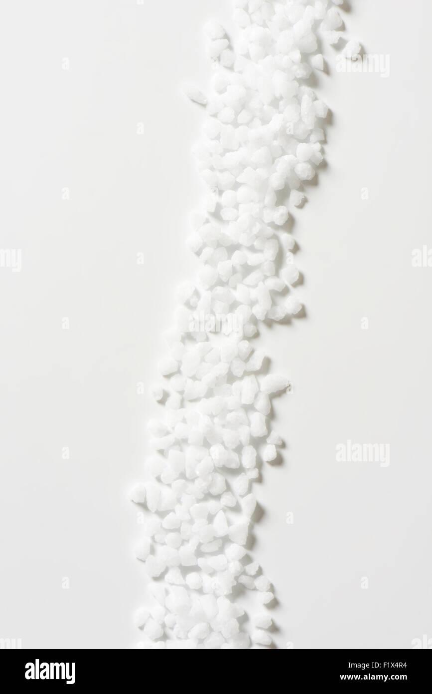 crystals of coarse grained sea salt - Stock Image