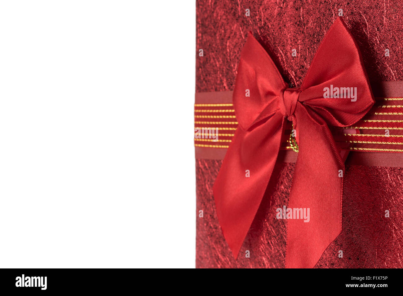 red greeting card with bow on the white background. - Stock Image