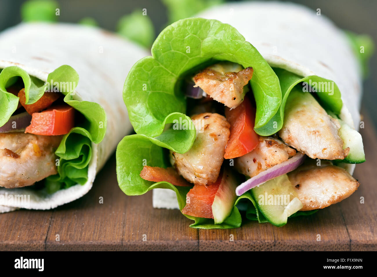Tortilla wraps on wooden table, close up view - Stock Image