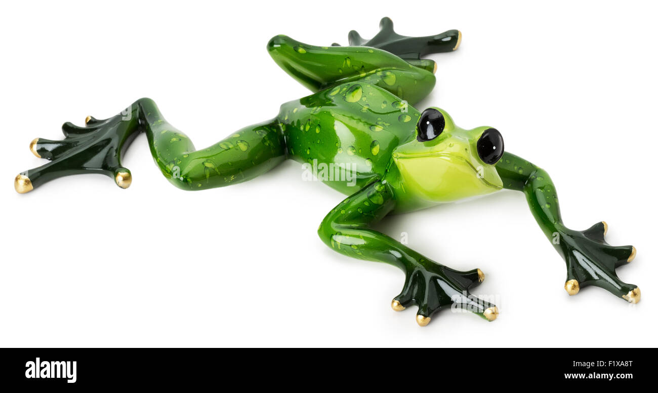 statue of green frog on the white background. - Stock Image