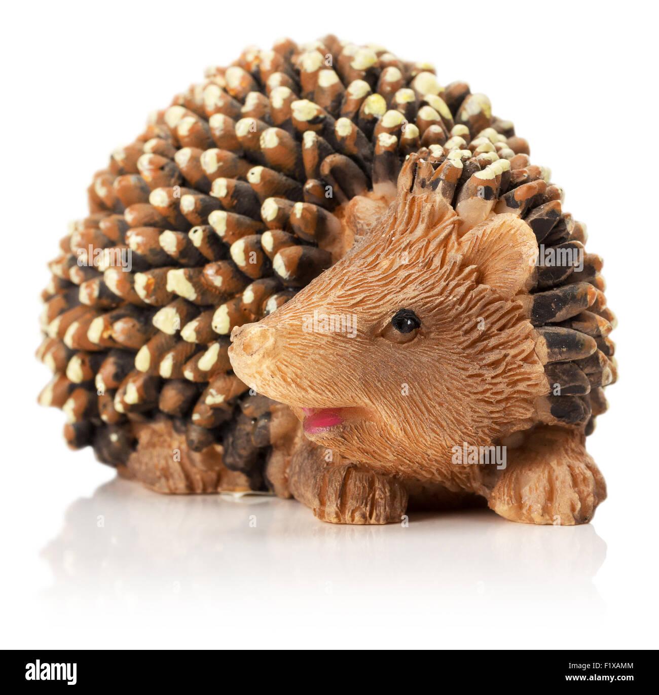 hedgehog figurine isolated on the white background. - Stock Image