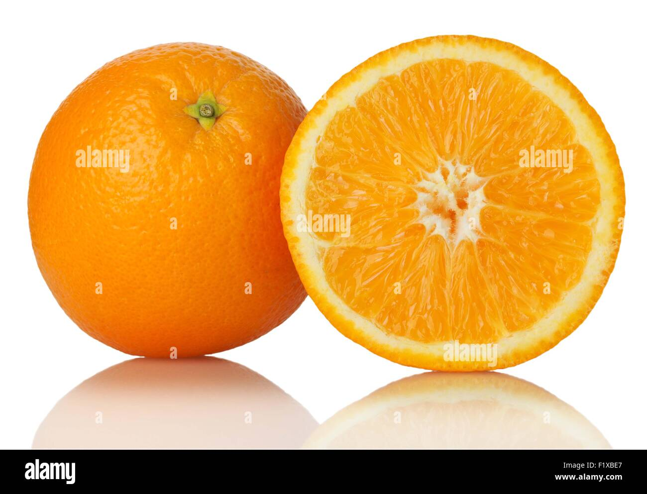 ripe oranges on white background - Stock Image