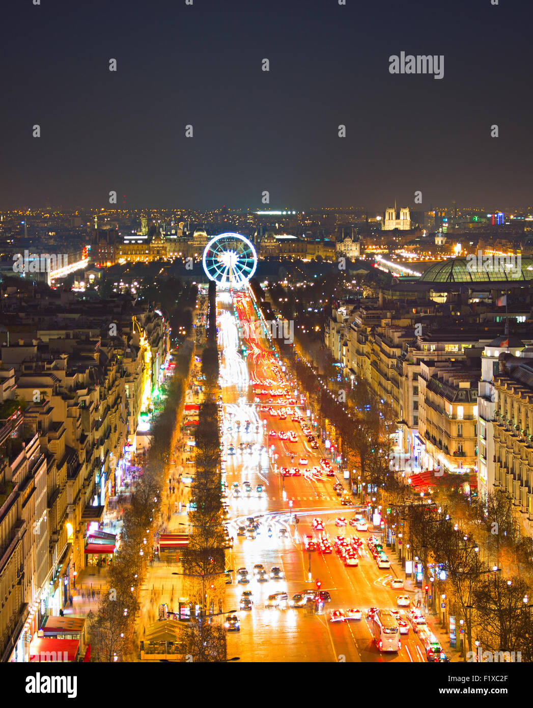 Avenue Champs-Elysees and ferris wheel  in Paris, France. View from Triumphal Arch - Stock Image