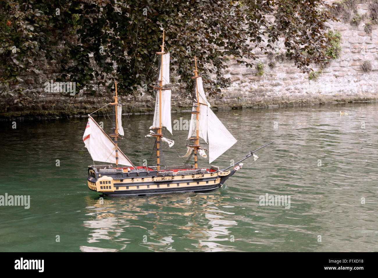 A radio controlled model Elizabethan galleon boat in the moat, Wells Somerset UK - Stock Image