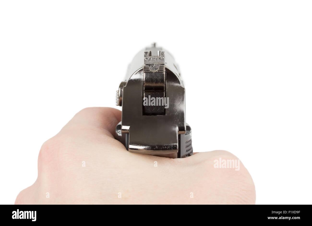 hand holding a handgun. - Stock Image