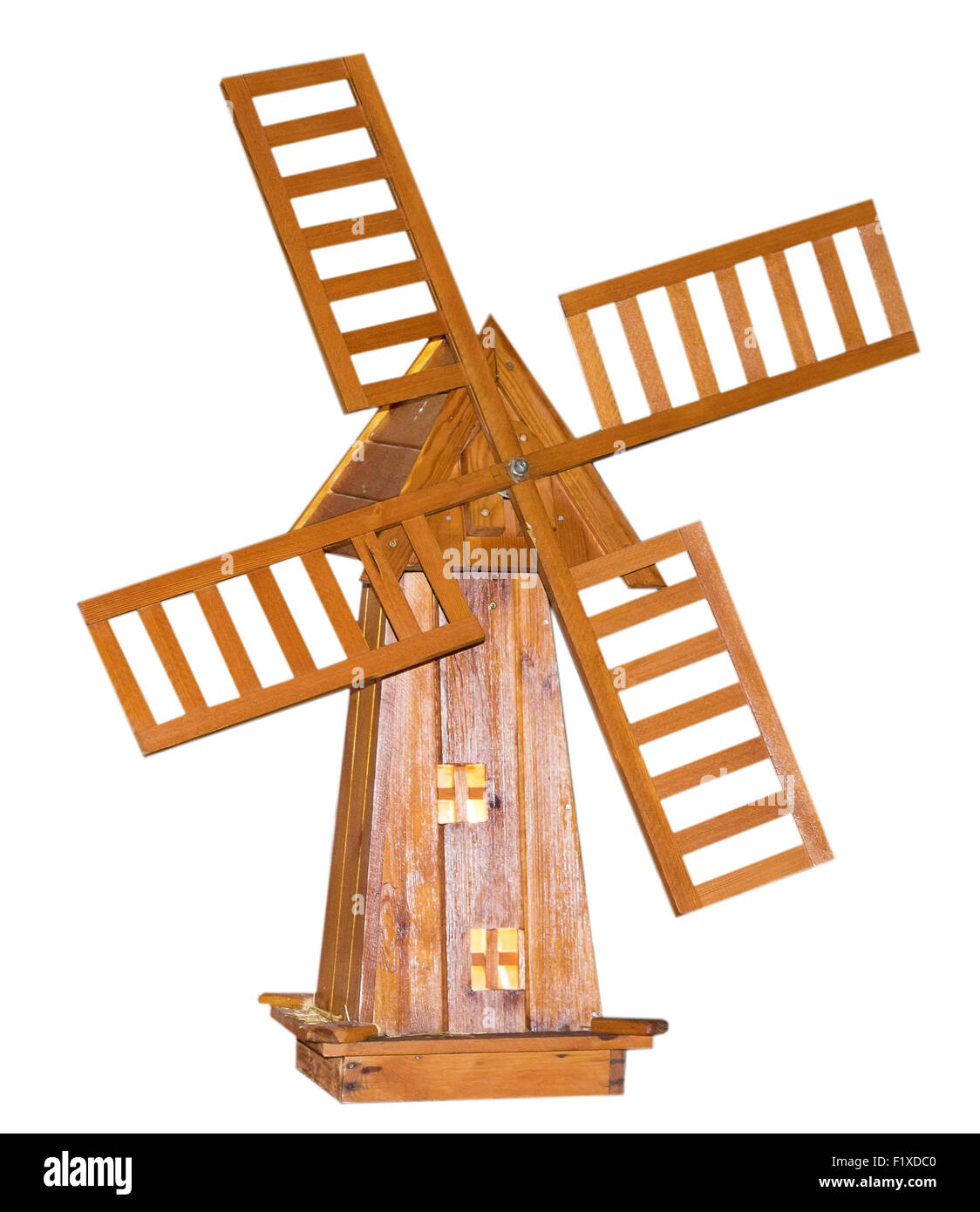 wooden windmill on white background. - Stock Image