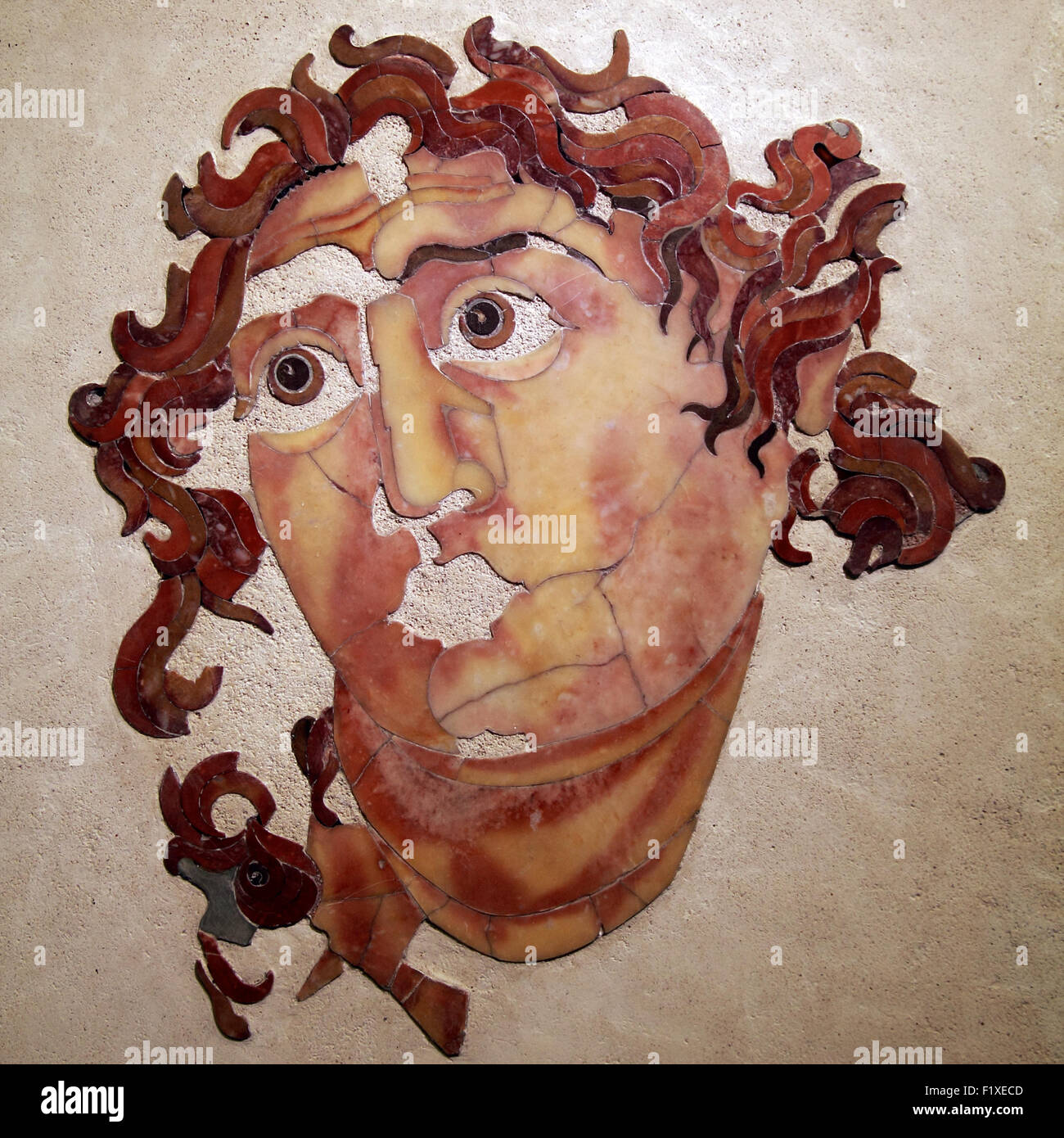 Head of Helios-Sol, opus sectile Mithraeum of Santa Prisca, Aventine Hill in Rome. National Museum of Rome. Italy. - Stock Image