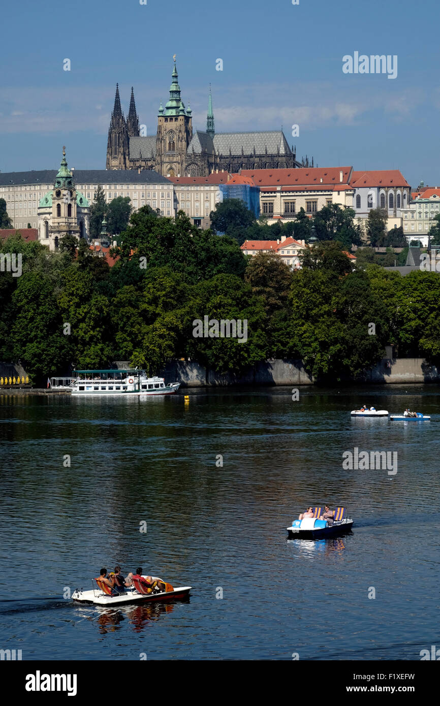 People riding a pedal boat on the Vltava river in Prague, Czech Republic, Europe - Stock Image