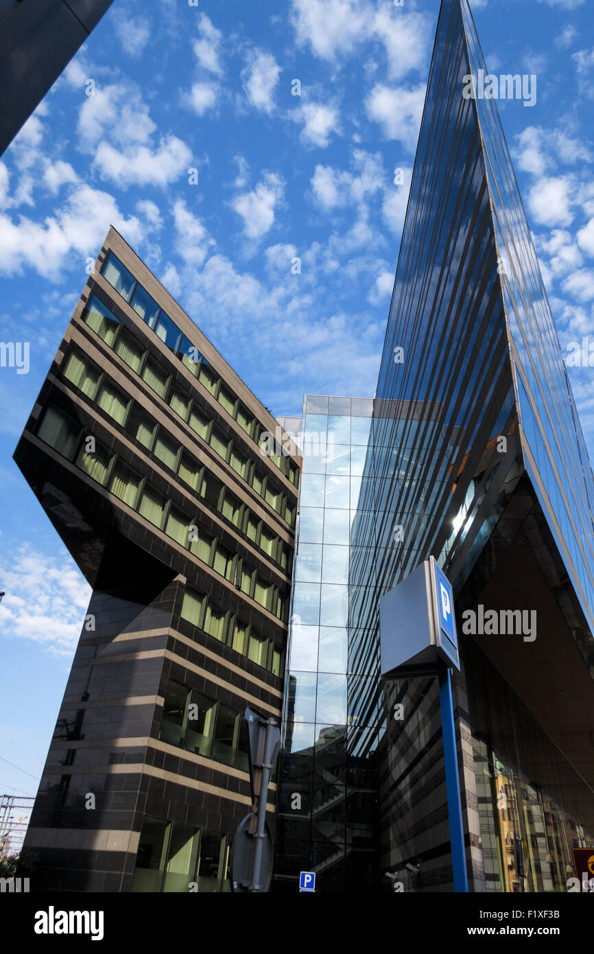 Buildings with modern architecture and angular glass facades - Stock Image