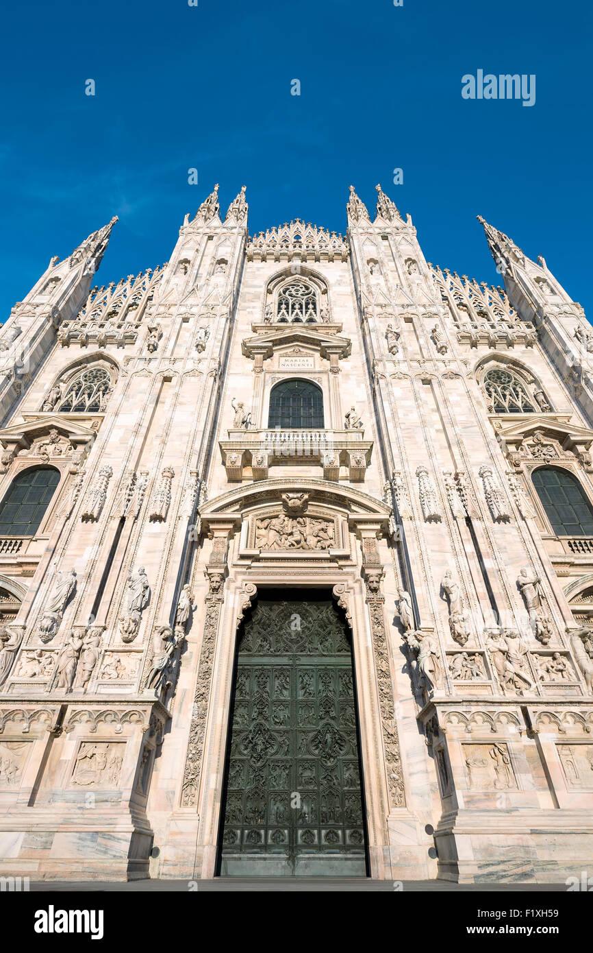 Milan Cathedral door (Duomo di Milano), Italy. Dedicated to Santa Maria Nascente - Stock Image