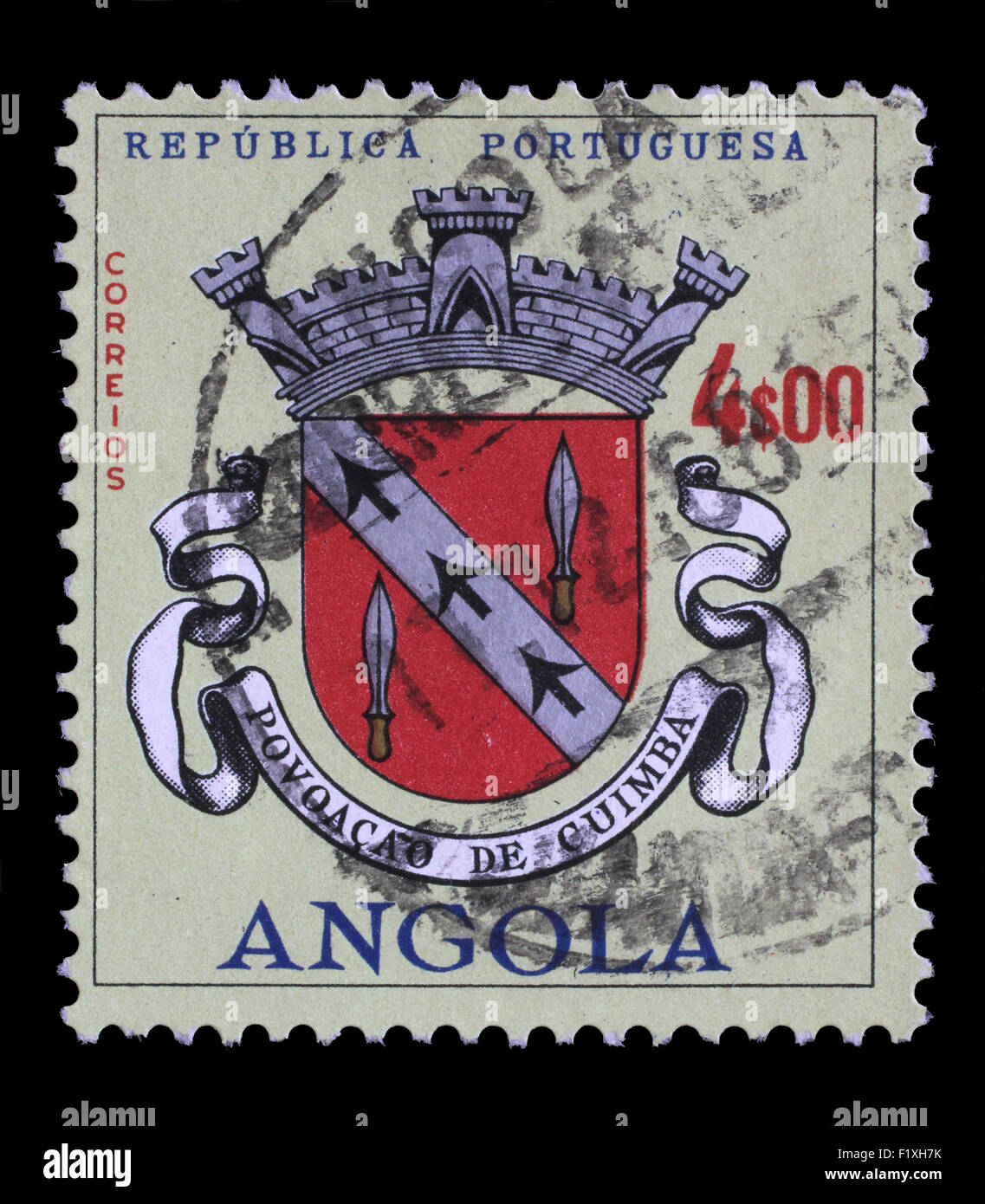 Stamp printed in the Angola shows Angolan Coat of Arms, Povoacao de Cuimba, circa 1963. - Stock Image
