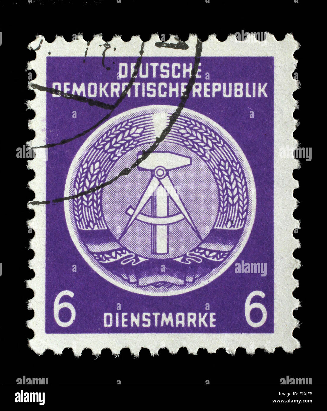Stamp printed in GDR (German Democratic Republic - East Germany) shows DDR national coat of arms, circa 1952 - Stock Image
