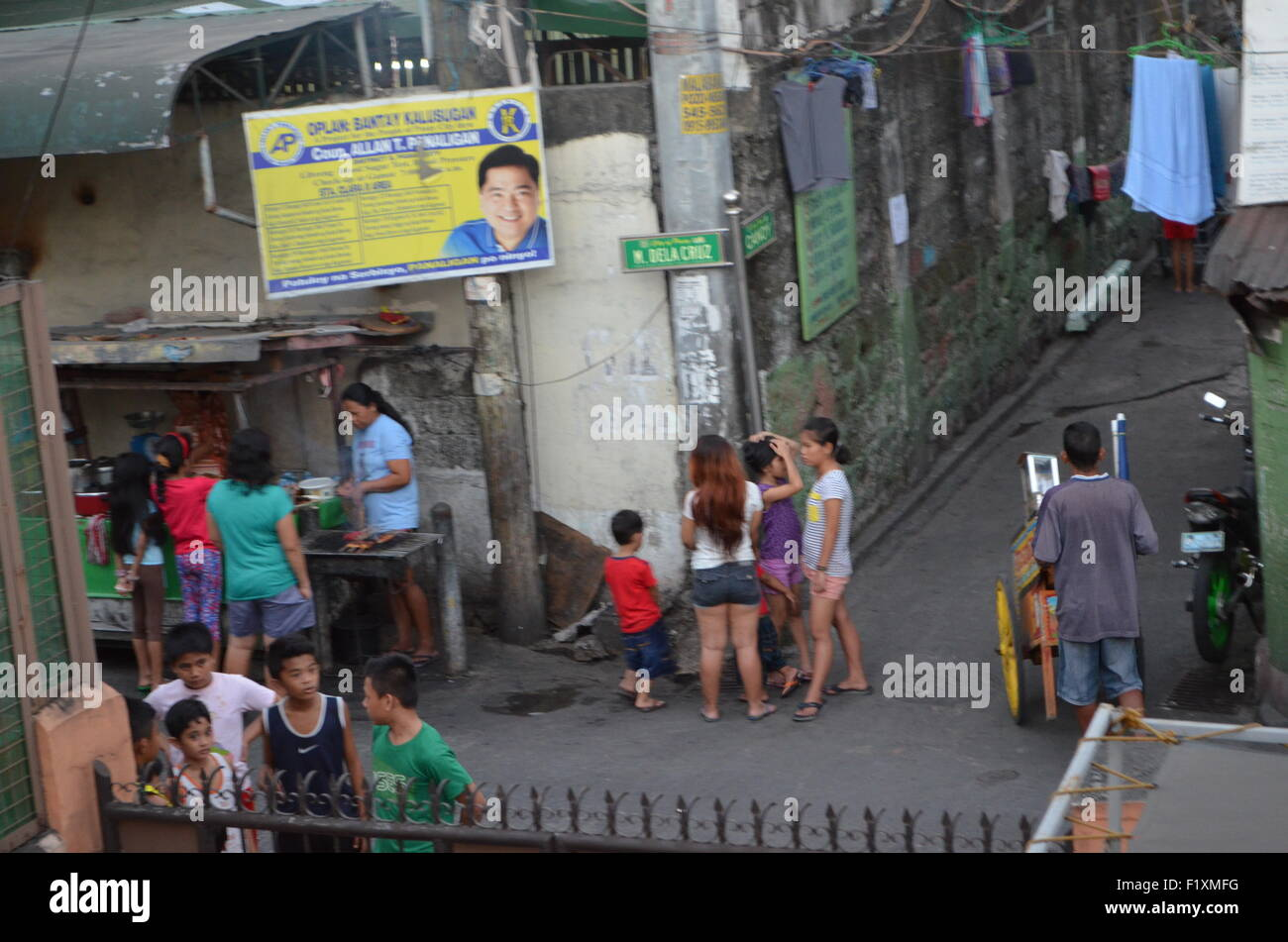 M.Dela Cruz, Manila.A streetcorner wherecrowds gather totaste thesausages being warmed upfor them.Above themthe - Stock Image