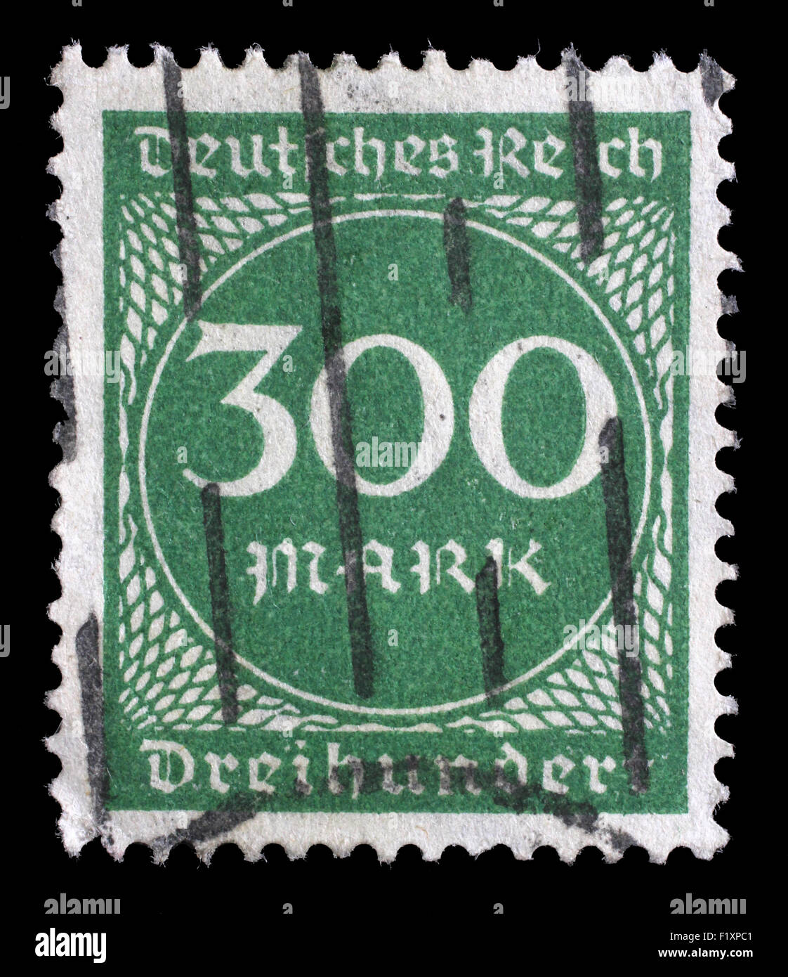 Stamp printed in Germany shows numeric value, circa 1923. - Stock Image