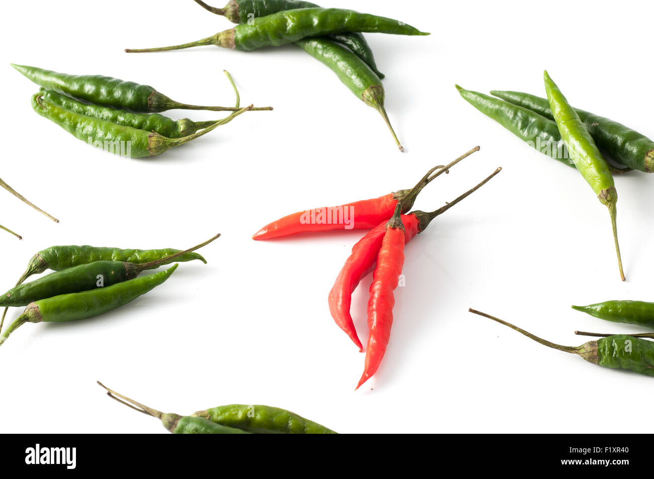 Red and green hot chili peppers - Stock Image