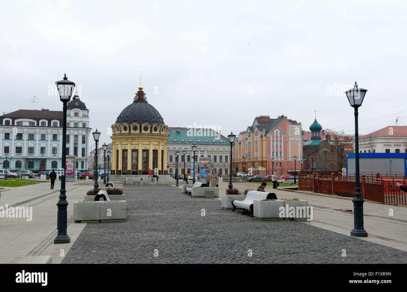 Colour on buildings still looks dull in the gray skies of Kazan, Tatarstan, Russia, making it look like a concrete - Stock Image