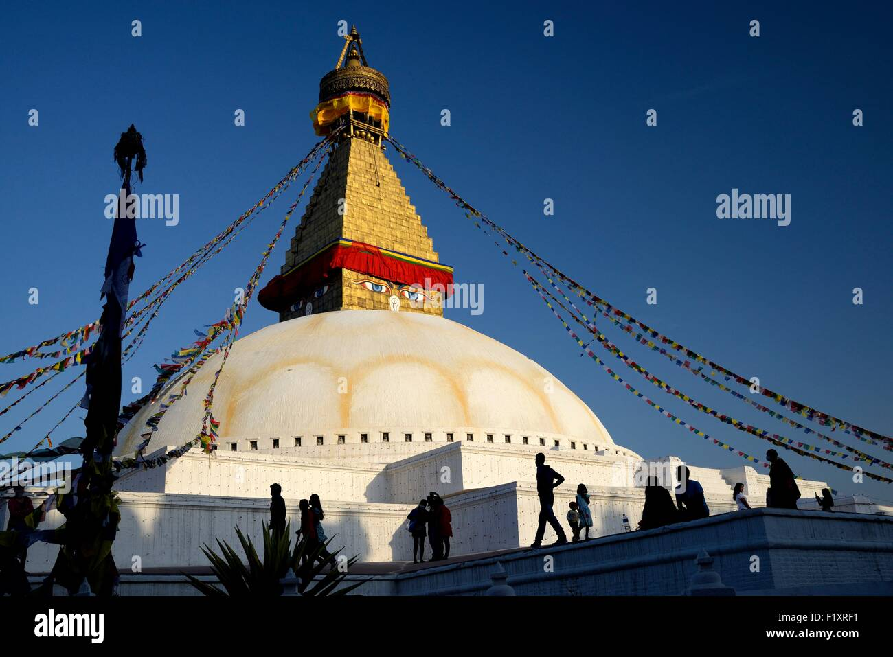 Nepal, Kathmandu valley, Bodnath listed as World Heritage by UNESCO, silhouette in front of the Bodnath stupa - Stock Image