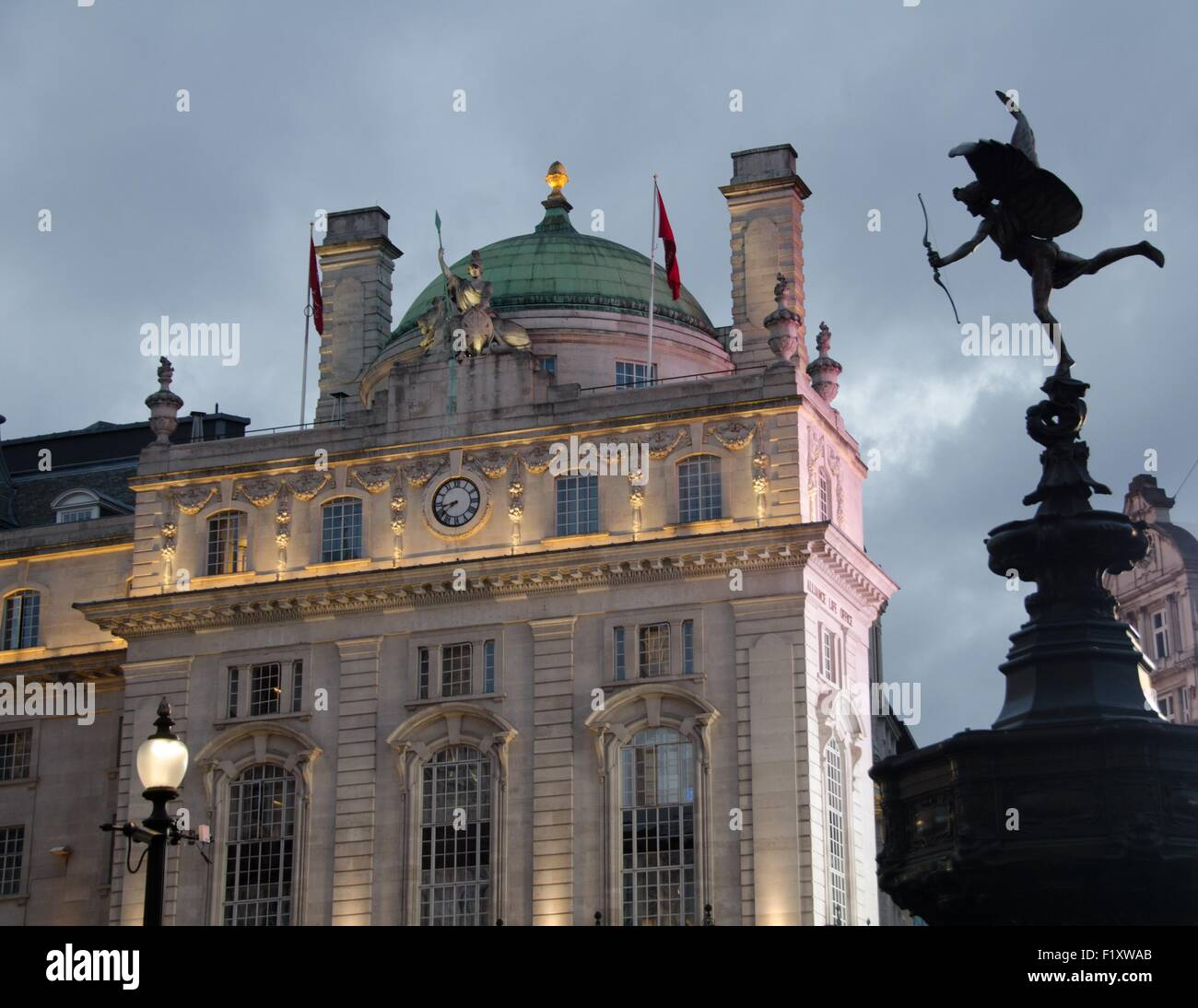 The Alliance Life Office behind the Eros statue in Piccadilly Circus, London, UK - Stock Image