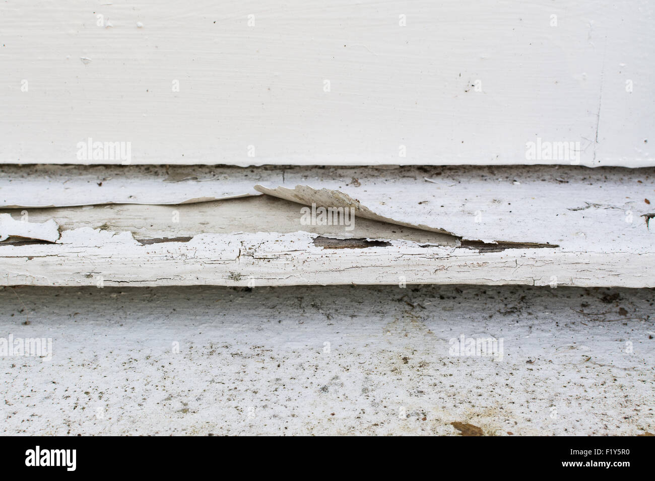 paint peeling from outside wooden window sill - Stock Image