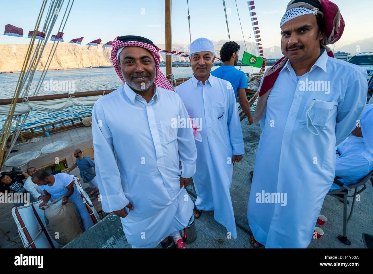 Oman, Khasab, Musandam, the port, Qataris cruising aboard an old dhow - Stock Image