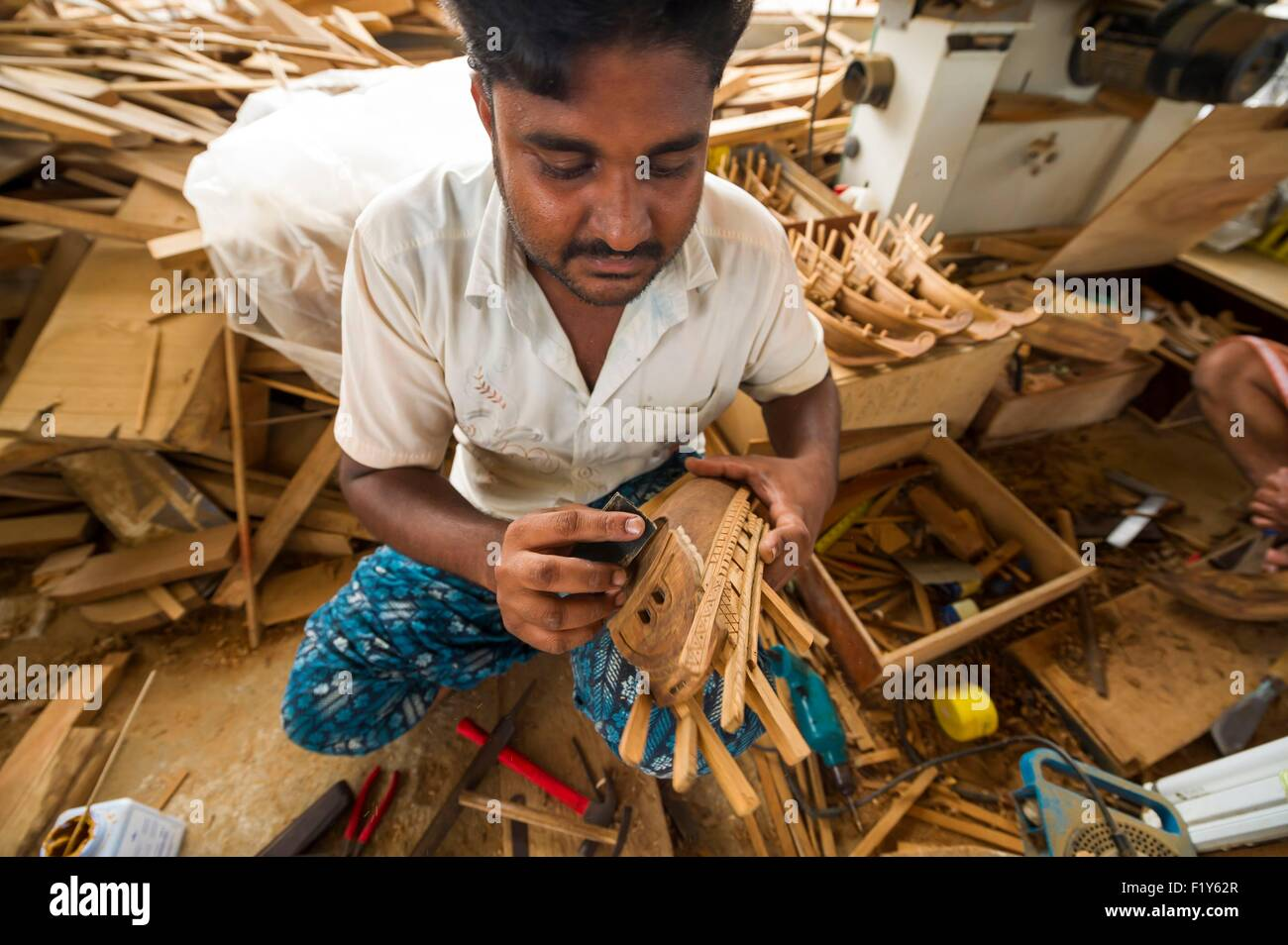 Oman, Sur, marine museum, naval factory of dhow, indian workers manufacturing scale models for tourists - Stock Image