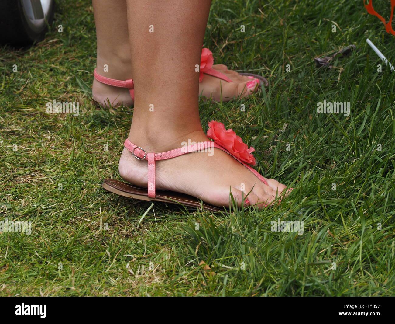 Mature tan feet in flip flops