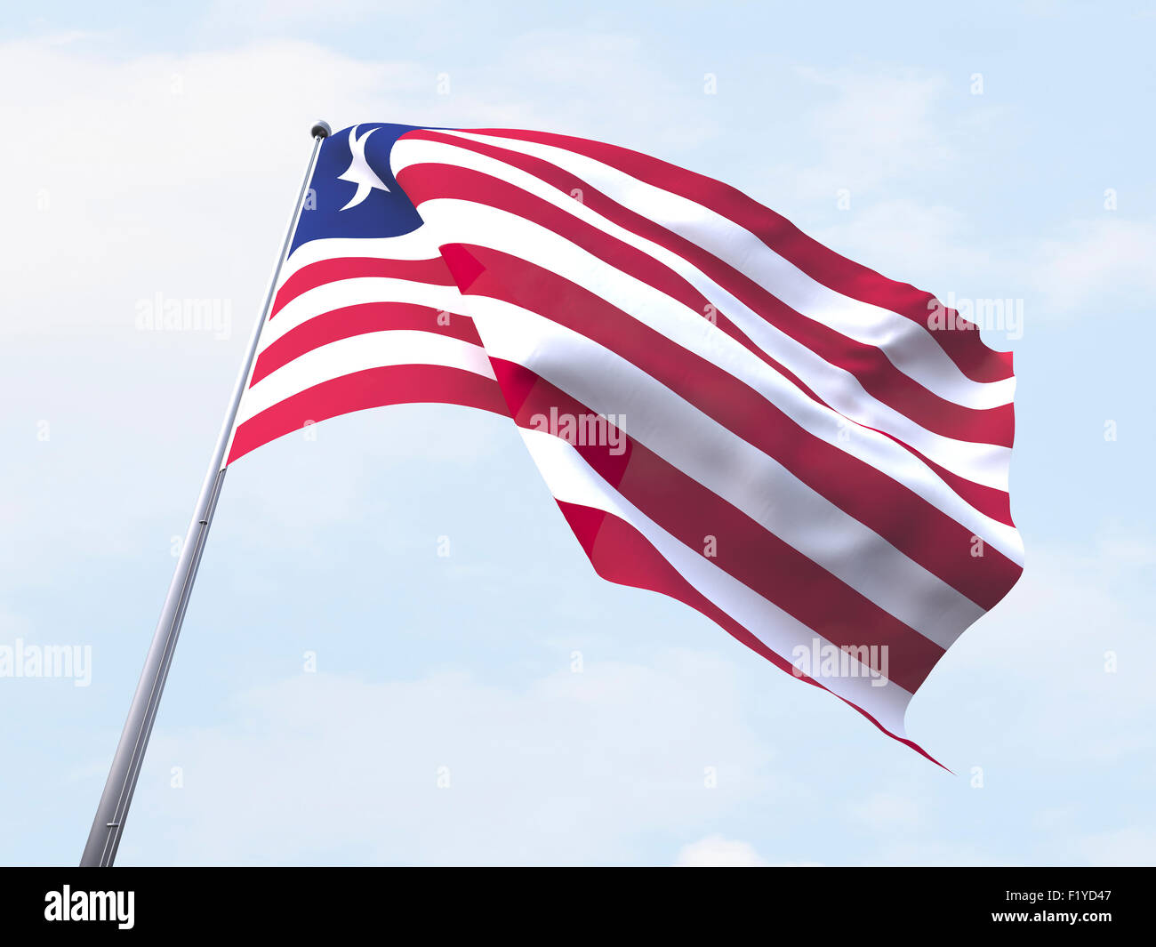 Liberia flag flying on clear sky. - Stock Image