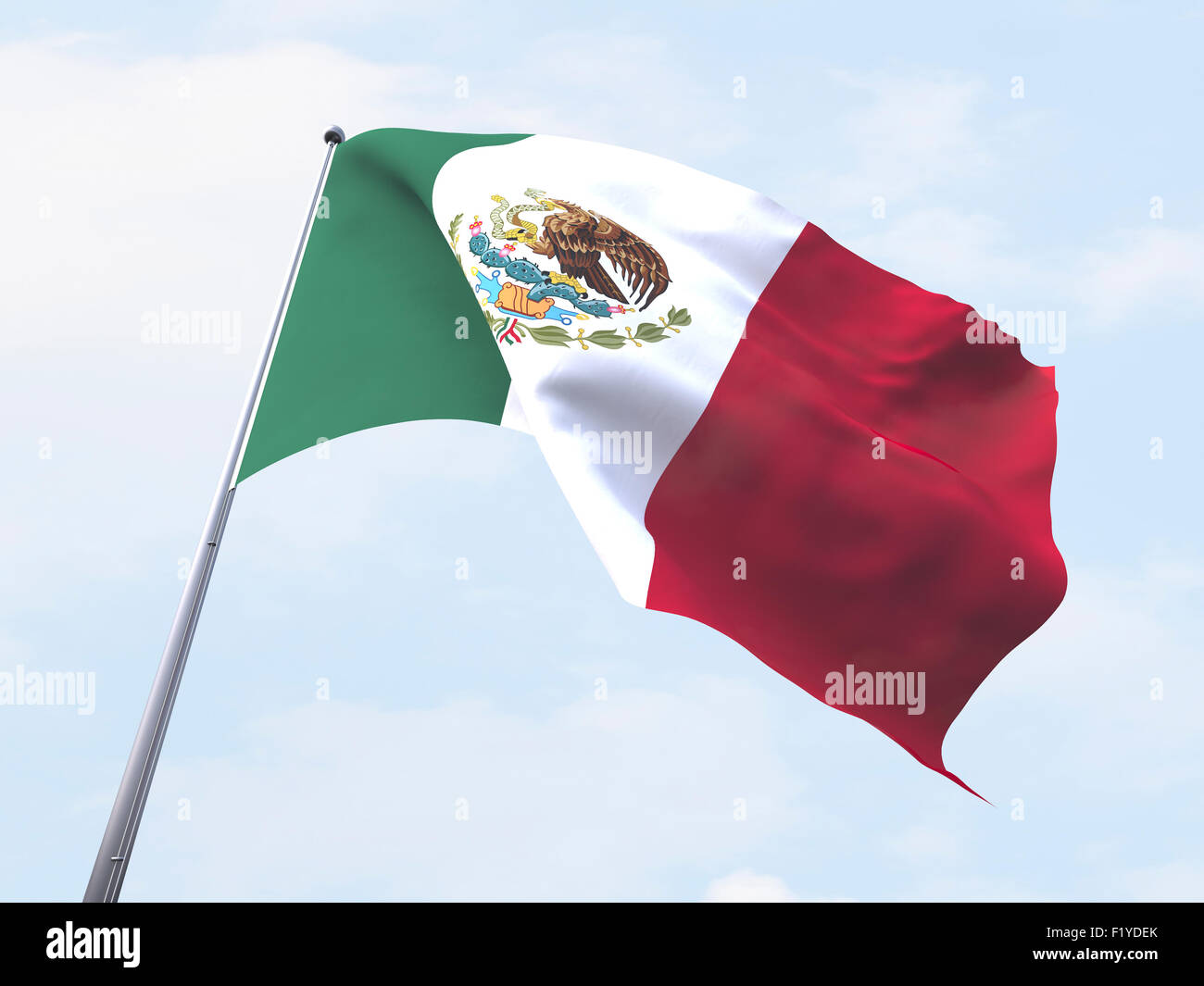 Mexico flag flying on clear sky. - Stock Image