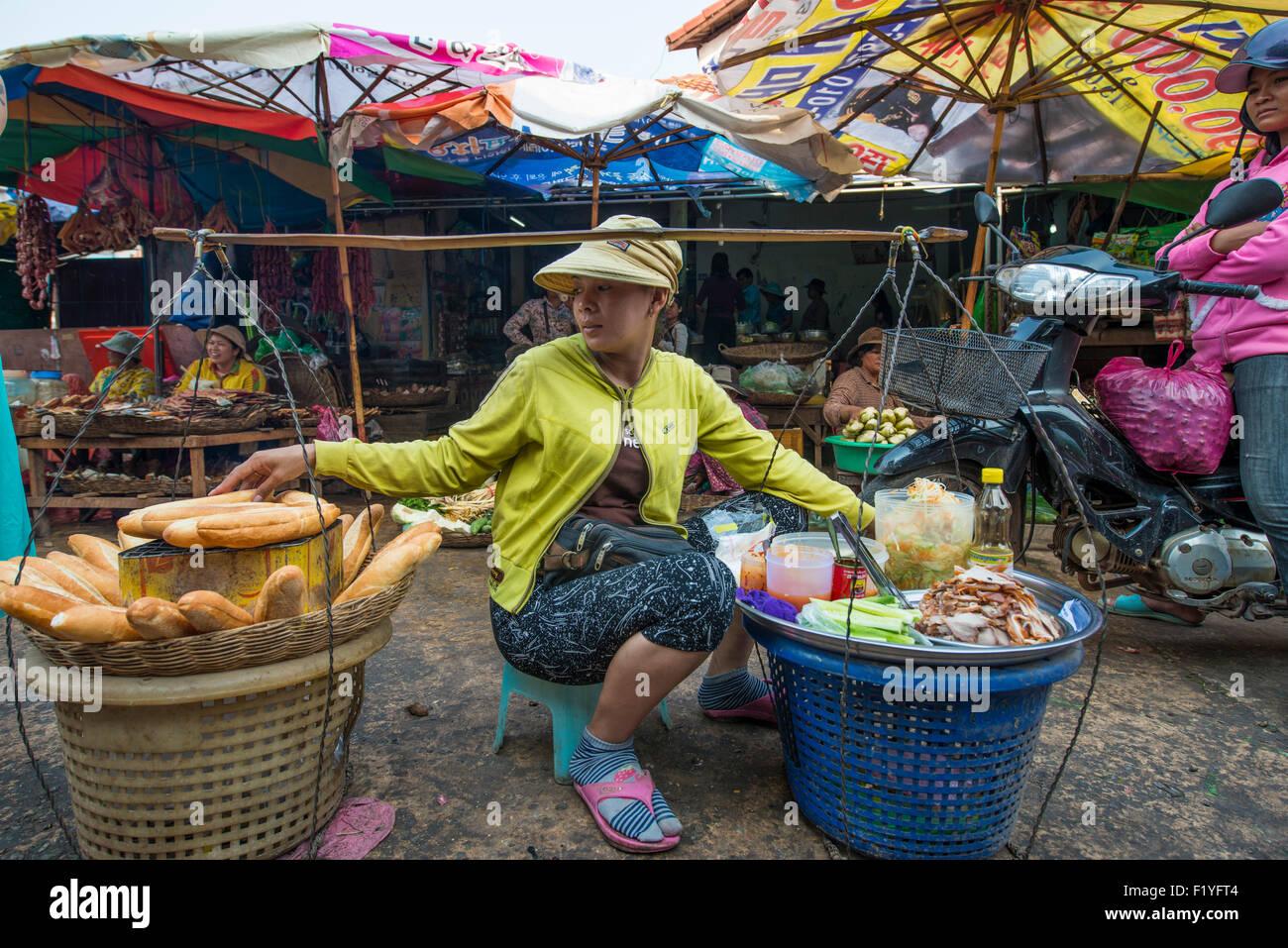 A street vendor selling the Vietnamese sandwich, banh mi in Siem Reap's Psar Leu Market. Local market. Siem - Stock Image