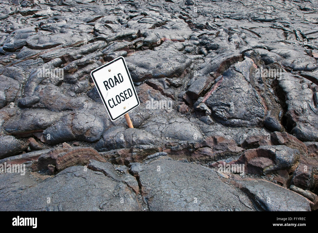 Lava flow and road sign on Chain of Craters Road, Big Island, Hawaii - Stock Image