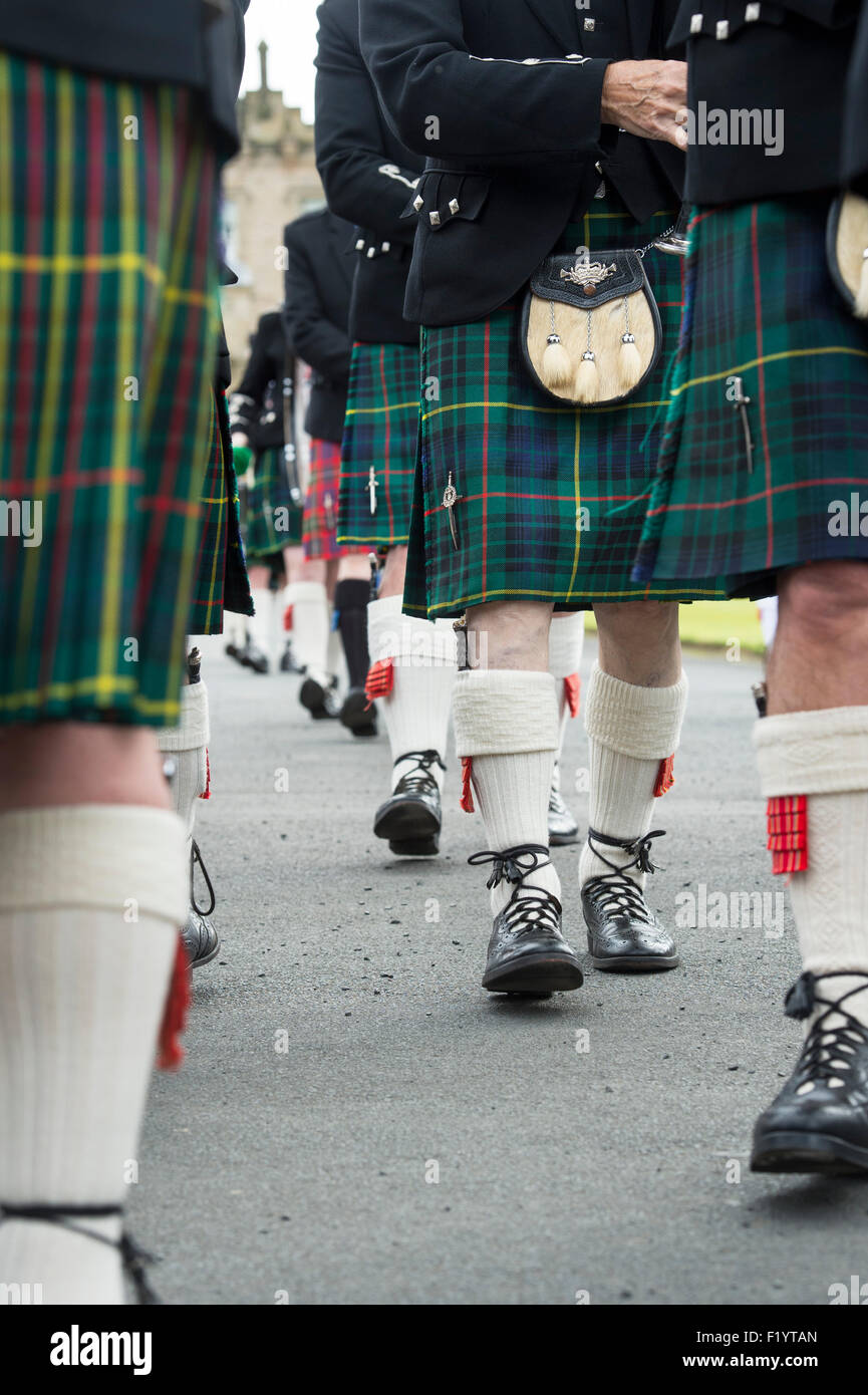 Bagpipers kilts abstract. Massed Pipe bands at Floors castle. Kelso, Scotland - Stock Image