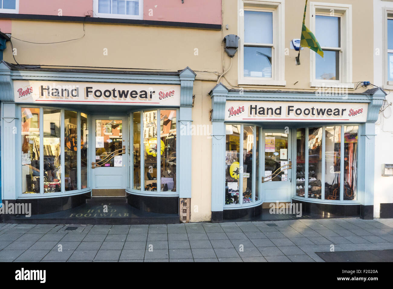Carrickmacross, County Monaghan, Ireland. Old-fashioned Hand Footwear shop, selling boots and shoes, painted blue - Stock Image