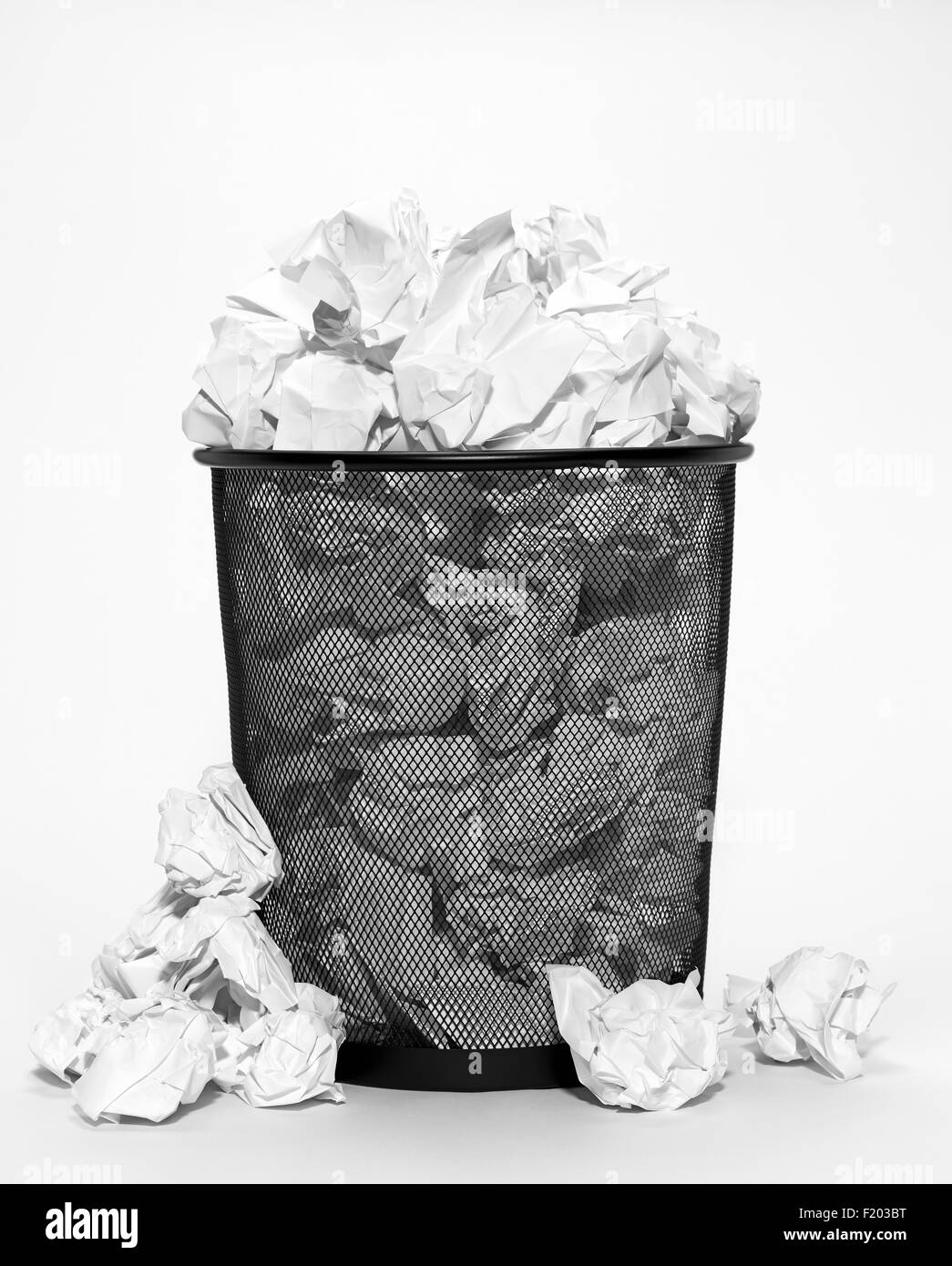 Isolated bin with crumpled paper - Stock Image