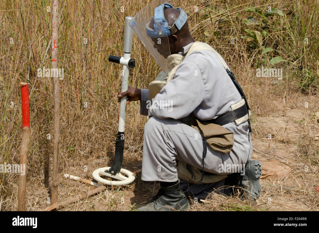 Angola, Mine clearence specialist preparing equipment used to look for unexploded ordenance. - Stock Image
