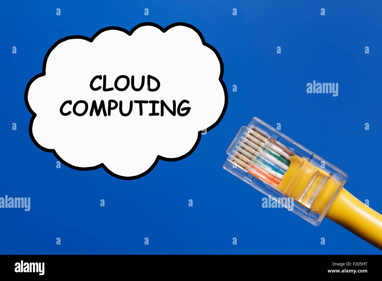 Cloud data storage/computing concept. LAN cable connecting into a cloud network on a plain sky blue background. Stock Photo