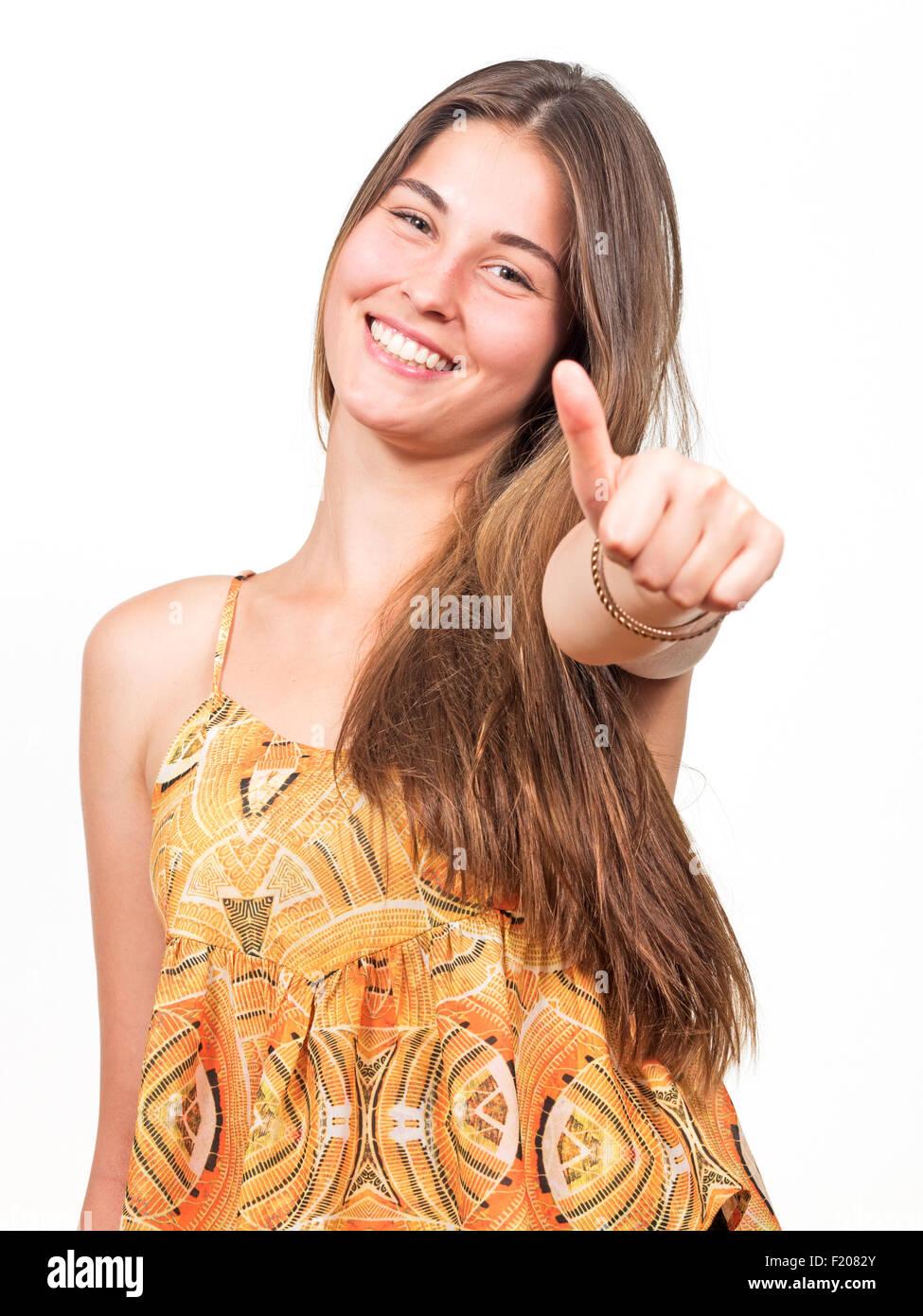 Junge Frau zeigt mit dem Daumen nach oben - Stock Image