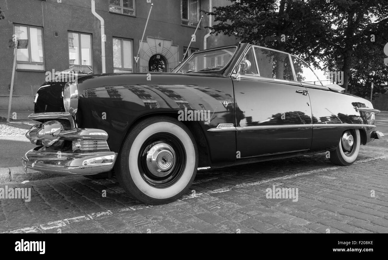 Helsinki, Finland - June 13, 2015: Old Ford Custom Deluxe Tudor car is parked on the roadside. 1951 year modification - Stock Image