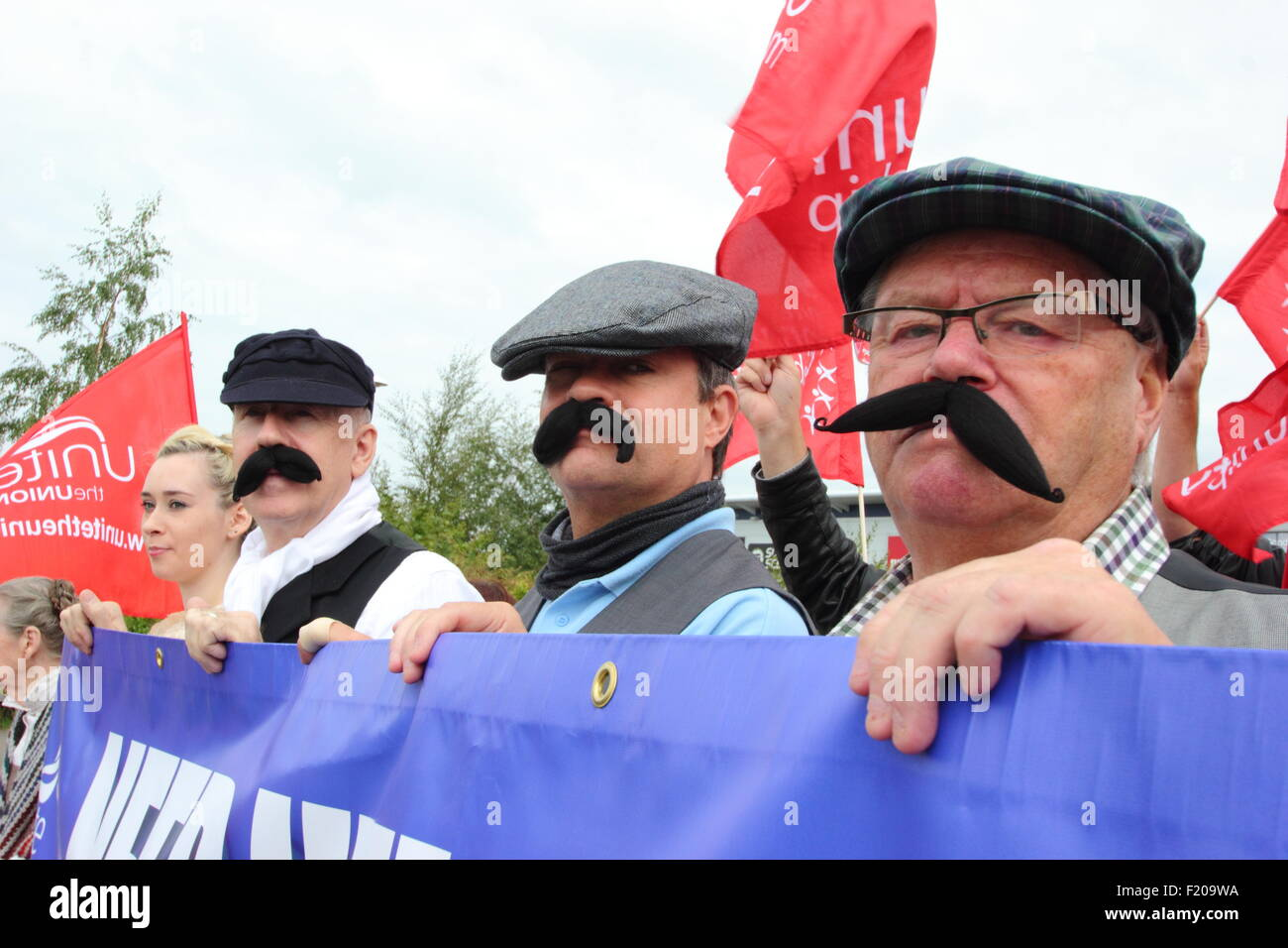 Shirebrook, Derbyshire, UK. 9 Sept 2015. Unite union supporters dressed in Dickensian-style clothing protest against - Stock Image