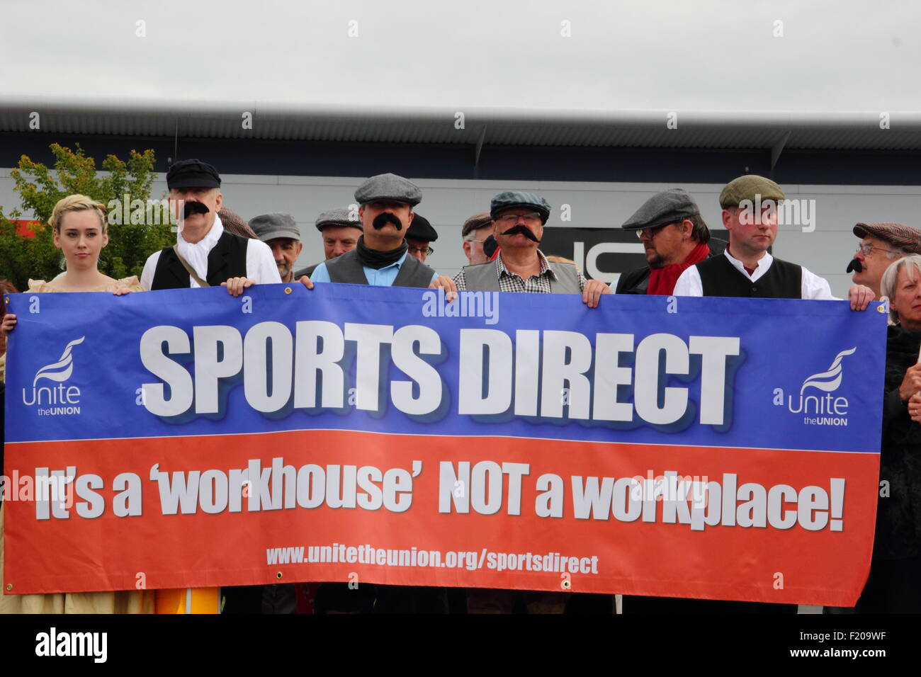 Shirebrook, Derbyshire, UK. 9 Sept 2015. Unite union supporters dressed as Dickensian-style workers protest against - Stock Image