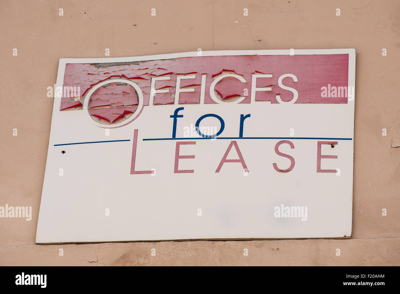 California, USA. 'Offices For Lease' sign with peeling red paint. - Stock Image