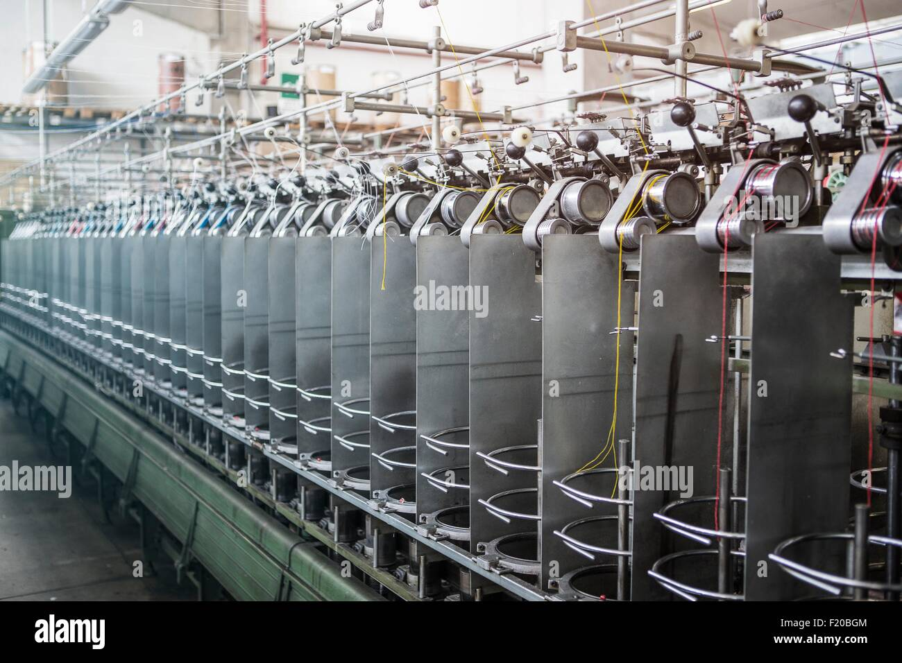 Machines making rope in factory that produces products for boating and camping - Stock Image