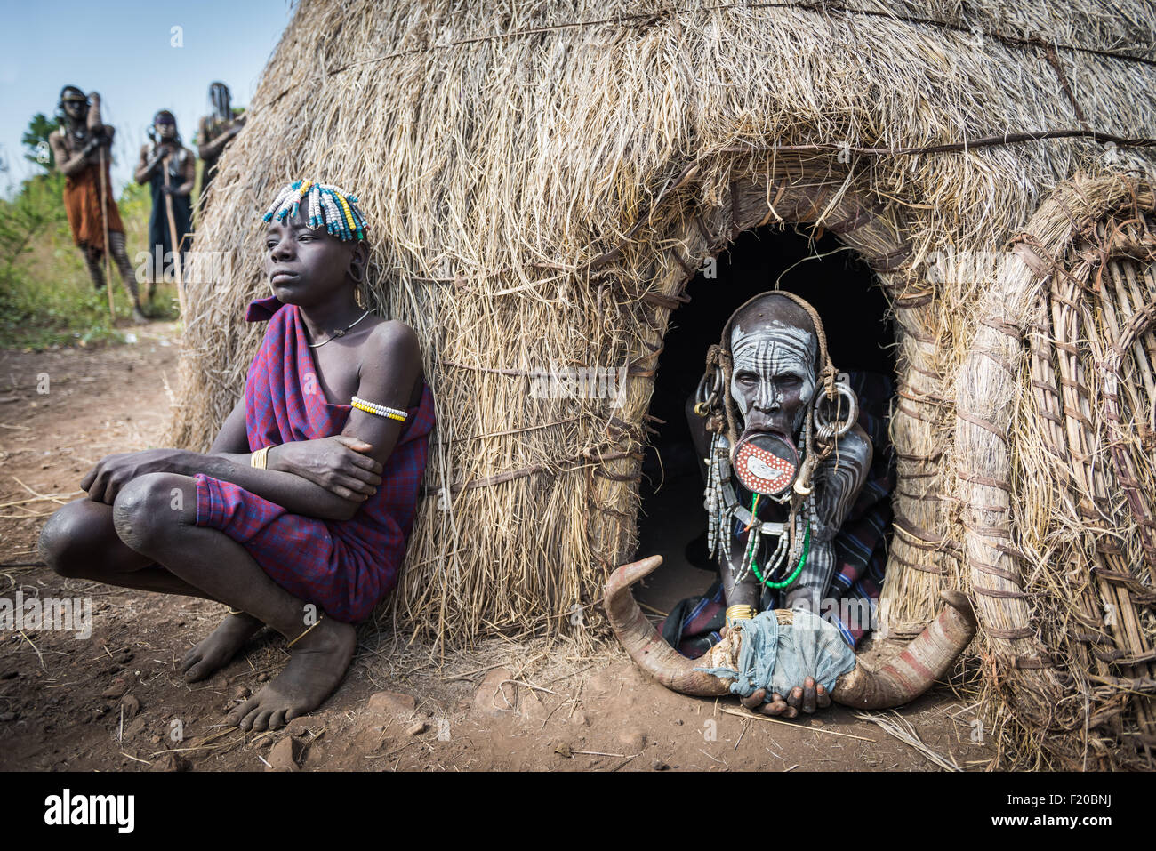 JINKA, ETHIOPIA, - 19 AUGUST 2015:unidentified women from Mursi tribe with big lip Plate, in Mago National Park,. - Stock Image
