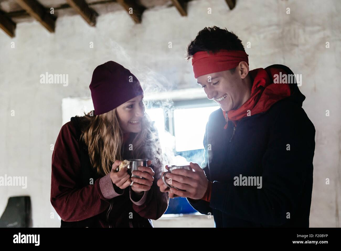 Young couple hiking, in shelter for rest, Honister Slate Mine, Keswick, Lake District, Cumbria, United Kingdom - Stock Image