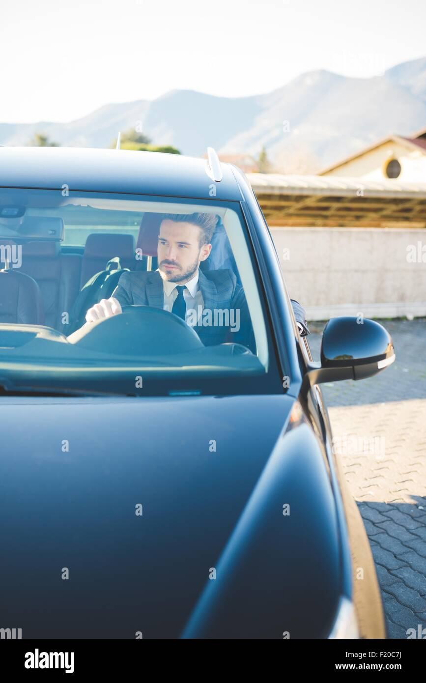 Young businessman sitting in car Stock Photo