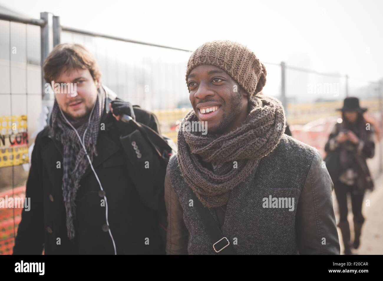 Young male friends strolling in park Stock Photo
