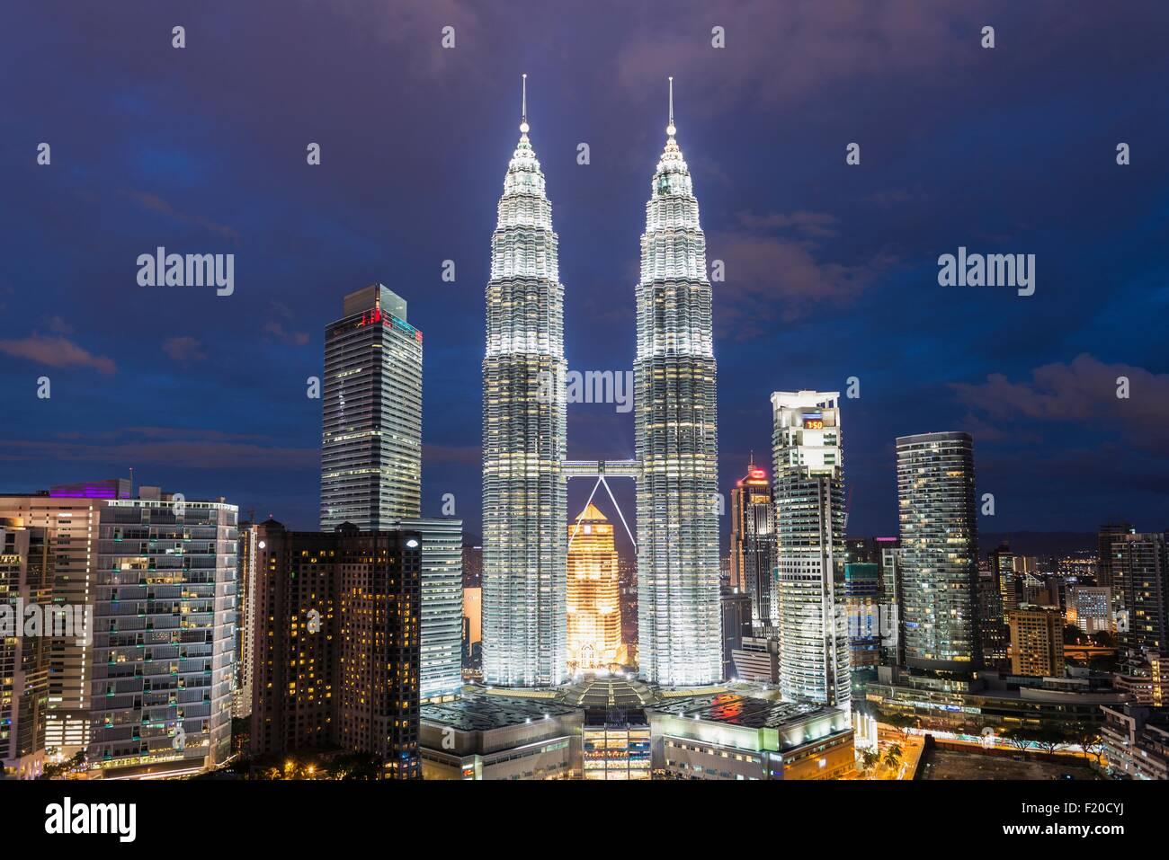 Petronas Towers illuminated at night, Kuala Lumpur, Malaysia - Stock Image